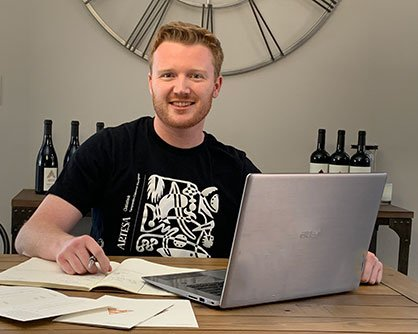 Tasting room host doing a virtual tasting on the computer at home.